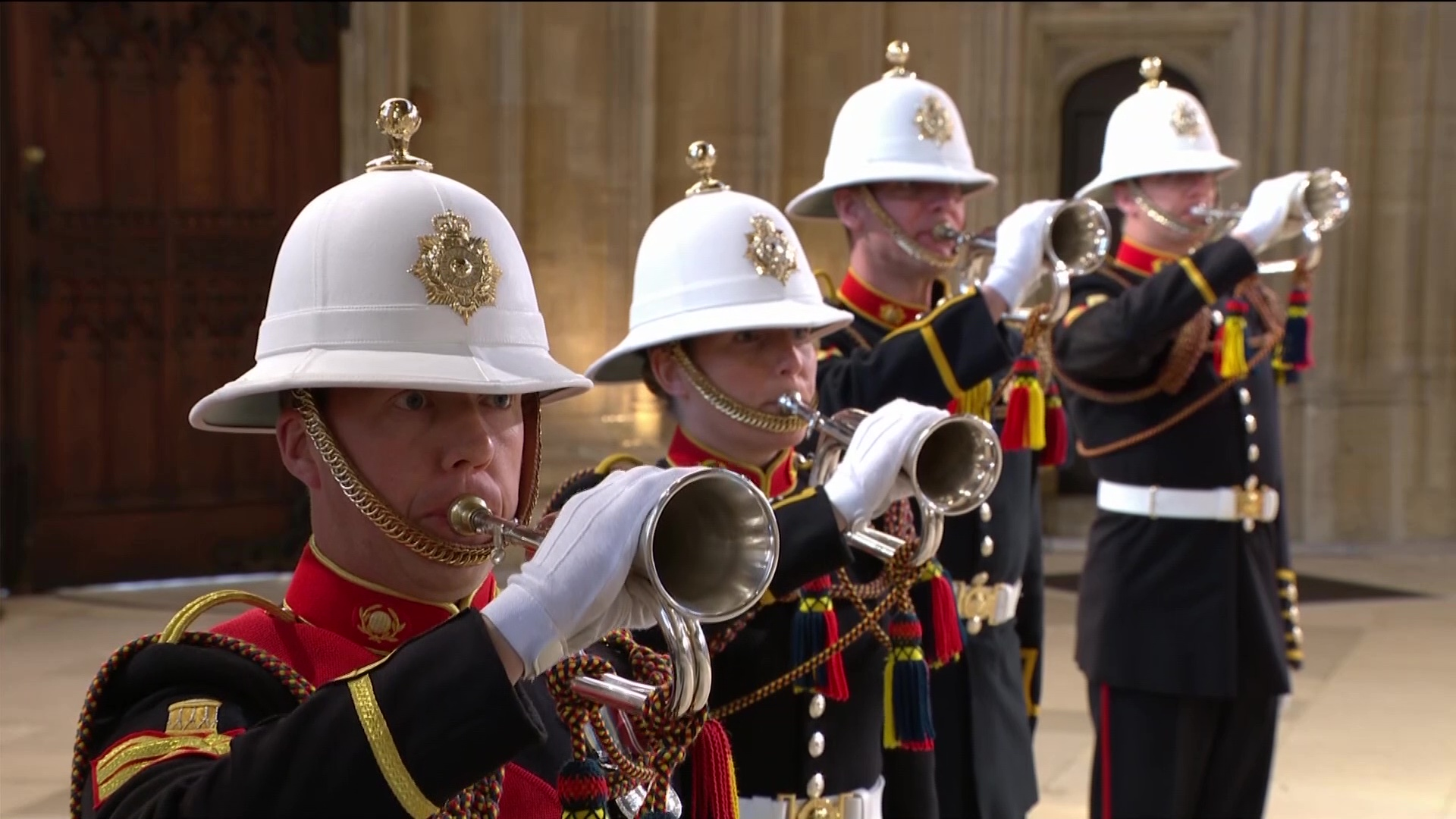 Royal Marines Buglers sound Action Stations during the funeral ceremony